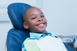 Smiling little boy in dental chair