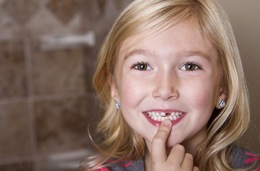Smiling child with missing tooth