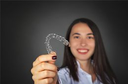 Teen girl holding aligner