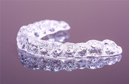 Close-up of used clear aligner