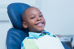 Smiling little boy in dental chair