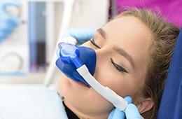 Patient with nitrous oxide nose mask