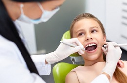 A young patient at her dental checkup.