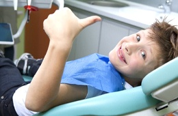 A young child at his dental appointment.